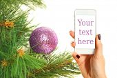 christmas tree and smartphone on white background