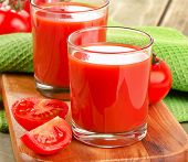 Tomato Juice And Ripe Tomatoes  On   Wooden Table
