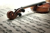 Detail Of Old Scratched Violin With Music notes