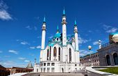 Qol Sharif mosque against the blue sky with white clouds