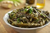 Sauteed bracken fern with sesame oil and seeds