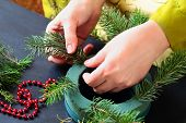 pic of christmas wreath  - Woman making christmas advent wreath - JPG