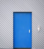 Blue door in a facade of corrugated iron