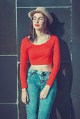Young Beautiful Girl In Red Blouse And Glasses