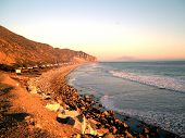 stock photo of pch  - The beautiful coastline of malibu approaching sunset - JPG