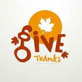 Thanksgiving Day concept with stylish text Give Thanks and maple leaf on grey background.