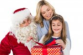 Mother and daughter with santa claus on white background