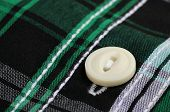 Button On A Cloth