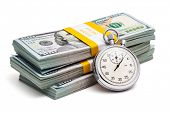 stock photo of bundle money  - Time is money loan concept background  - JPG