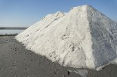 stock photo of salt mines  - Big heap of sea salt extracted through natural evaporation at the salt lake near Burgas Bulgaria - JPG