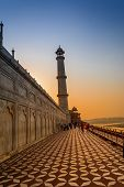 stock photo of mughal  - The Taj Mahal is the epitome of Mughal art and one of the most famous buildings in the world - JPG