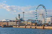Quay Of Helsinki With Moored Ships And Ferris Wheel