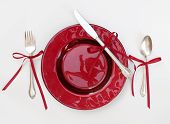 Christmas Dinnerware Setting with Red Ribbons