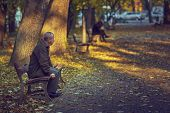 Lonely Retired Man On A Bench
