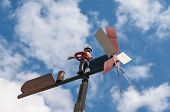 foto of rudolph  - particular of a vane against the blue sky - JPG