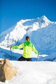 Man Hiking In White Winter Mountains
