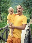 Baby and father on a bridge