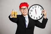 Happy Asian Businessman With Beer And Clock At  Midnight