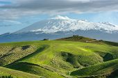 cultivated land and majestic of volcano Etna snow covered, Sicily