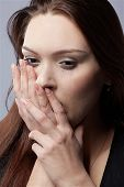 picture of young women  - portrait of beautiful crying girl with smeared mascara hiding her face in hands - JPG