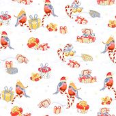 Christmas seamless pattern with bullfinches and holiday symbols.
