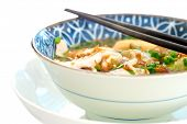 Healthy chinese style fish soup with tofu and herbs