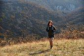 Hiker Woman Walking In Autumn Mountains