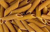 Macro Closeup Background Texture Of Whole Wheat Rigatoni Pasta