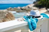 Sun glasses and a hat on a background of the sea.