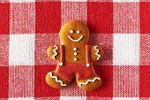 Christmas homemade gingerbread man on tablecloth