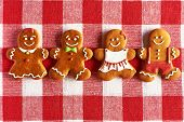 Christmas homemade gingerbread couples on tablecloth