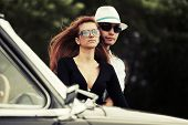 Young fashion couple in love at the classic car outdoor