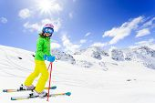 Ski, winter fun - lovely skier girl enjoying skiing