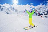 Skiing, freeski, winter sport - skier on mountainside