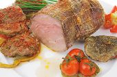 roast meat in grid with chives on plate