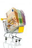 euro bank notes in a shopping cart, photo icon for purchasing power, shopping, money printing and inflation