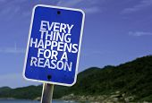 Every Thing Happens For a Reason sign with a beach on background