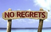 No Regrets sign with a beach on background