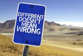 Different Doesn't Mean Wrong sign with a desert background