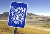 Silence Speaks When Words Cant sign with a desert background