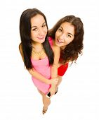 Two funny young girls isolated
