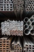 picture of ferrous metal  - Metal pipes and angle iron stack for construction - JPG
