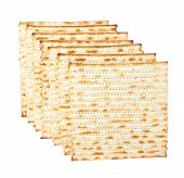 picture of matzah  - Multiple machine made matza flatbreads lying one over another - JPG