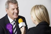foto of politician  - Politician Being Interviewed By Journalist During Election - JPG