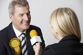 image of politician  - Politician Being Interviewed By Journalist During Election - JPG
