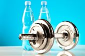 pic of rep  - shiny fitness dumbbells for training on blue background - JPG