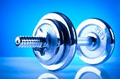 picture of rep  - shiny fitness dumbbells for training on blue background - JPG