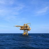 foto of offshore  - Three Legged Oil and Gas Production Platform at Offshore - JPG