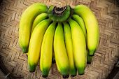 pic of festering  - Ripe bananas on a bamboo tray stock photo - JPG