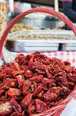 stock photo of pimiento  - Wicker basket full of dry red peppers in a weekly sicilian market - JPG